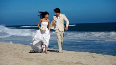 Wedded couple on a beach in hawaii