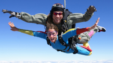 Couple tandem skydiving